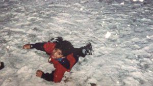 Young Oscar playing in the snow
